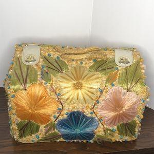 Vintage straw embroidered picnic basket